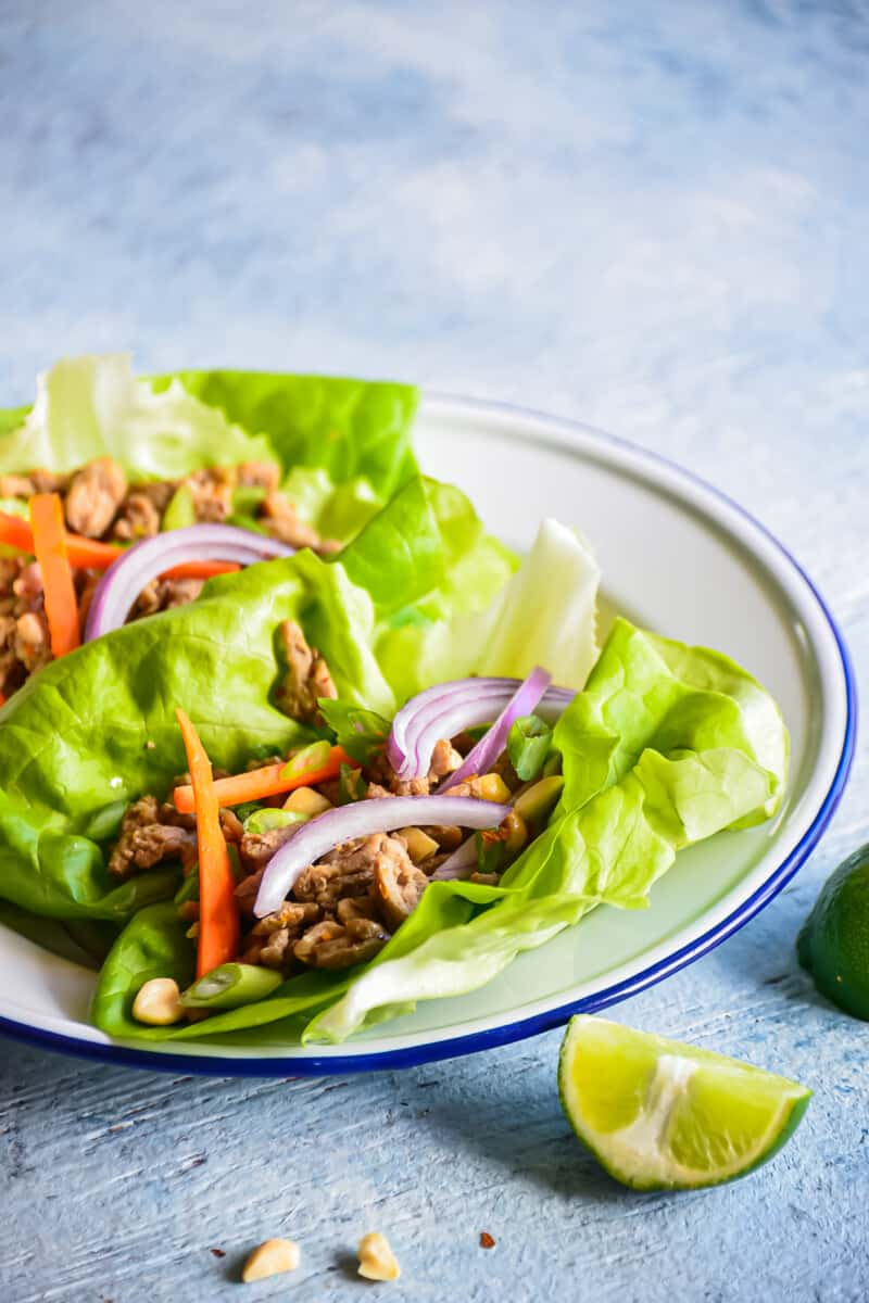 turkey lettuce wraps on a white plate
