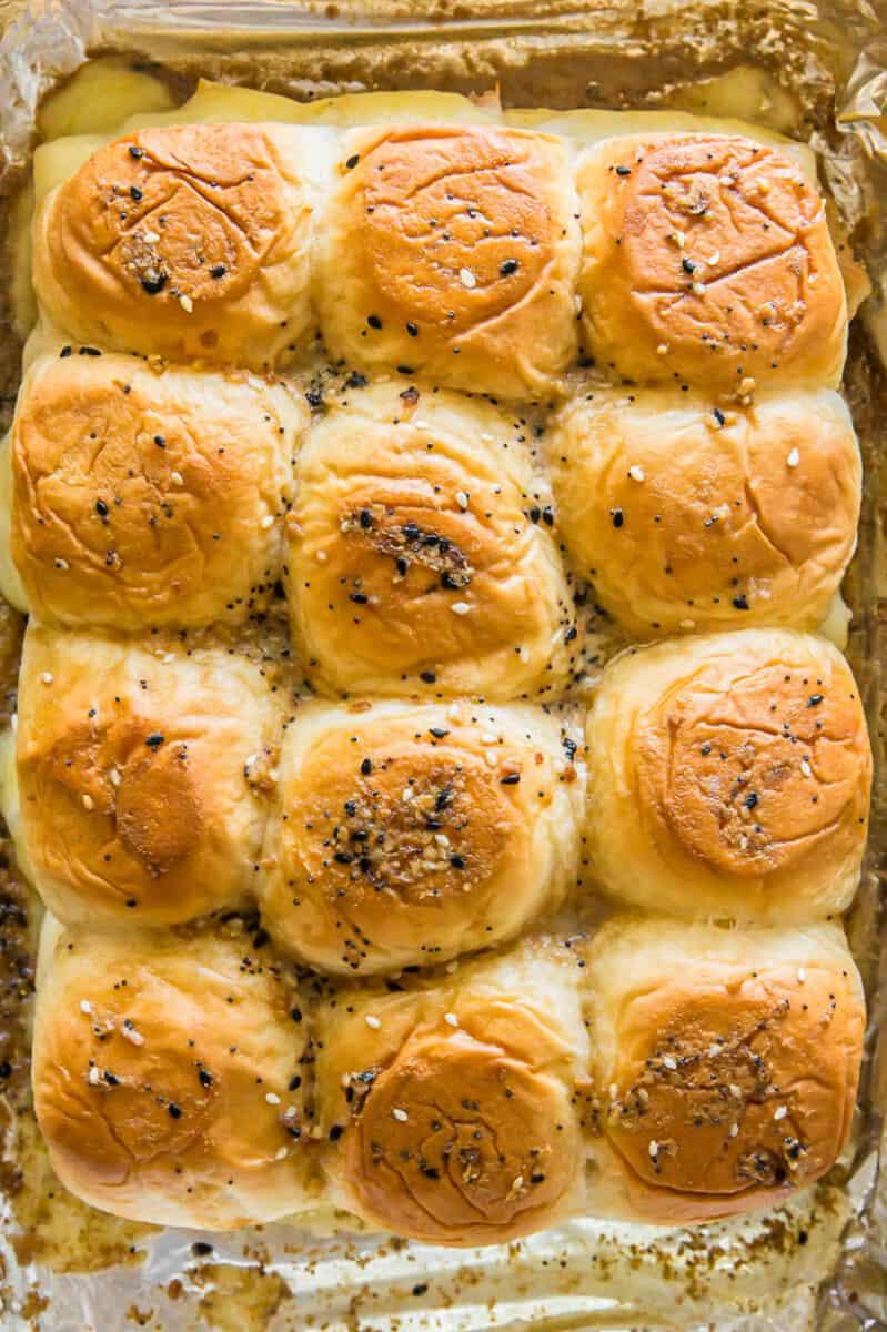 Baked turkey sliders on baking sheet.