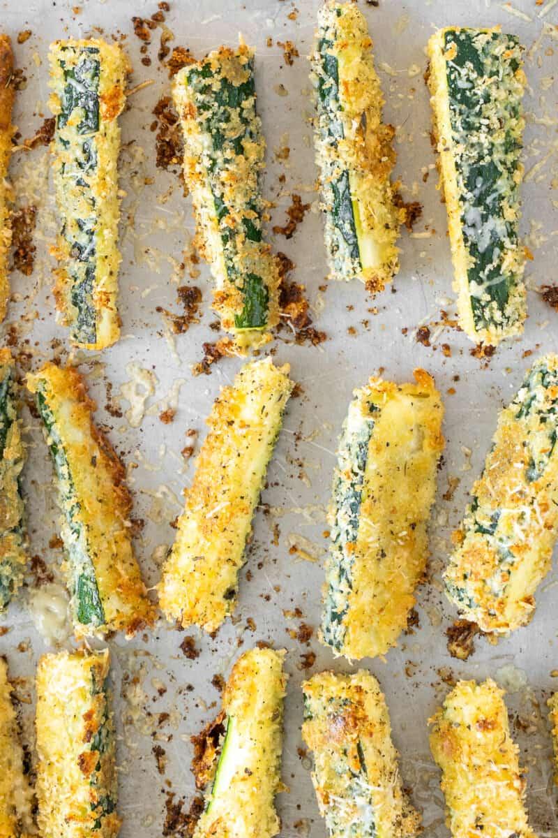 crispy zucchini fries on baking sheet