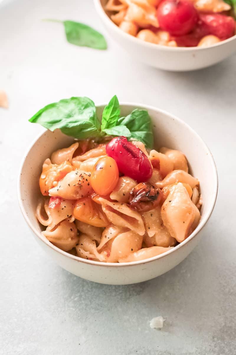 bowl of parmesan pasta with fresh basil