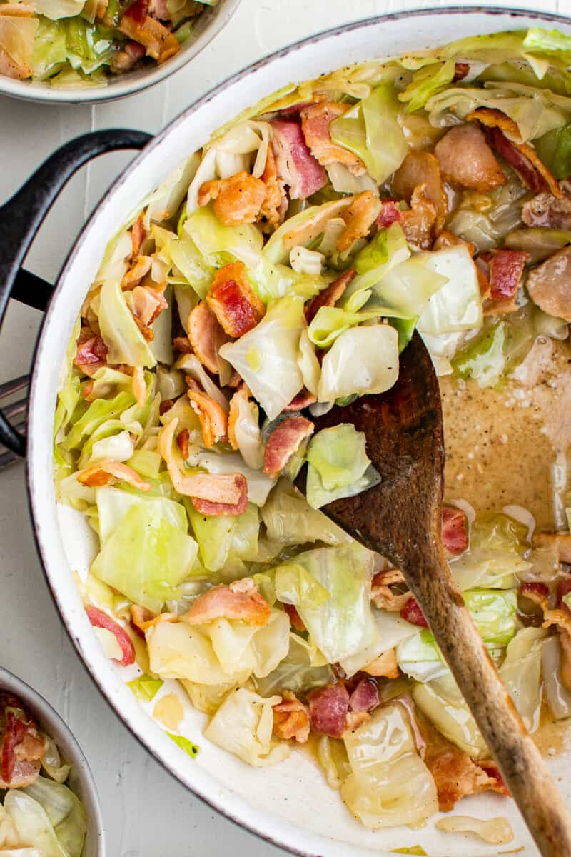 wooden spoon in cabbage and bacon
