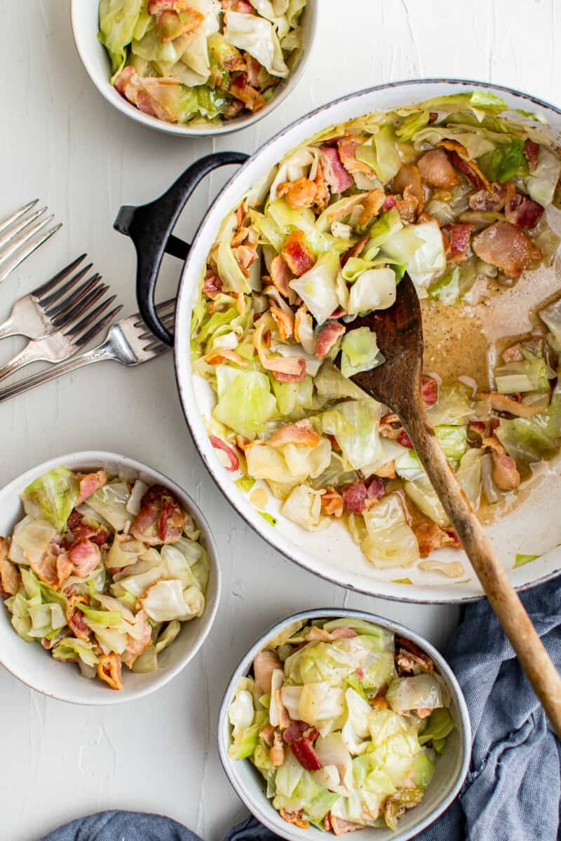 dutch oven with cabbage and bacon and bowls