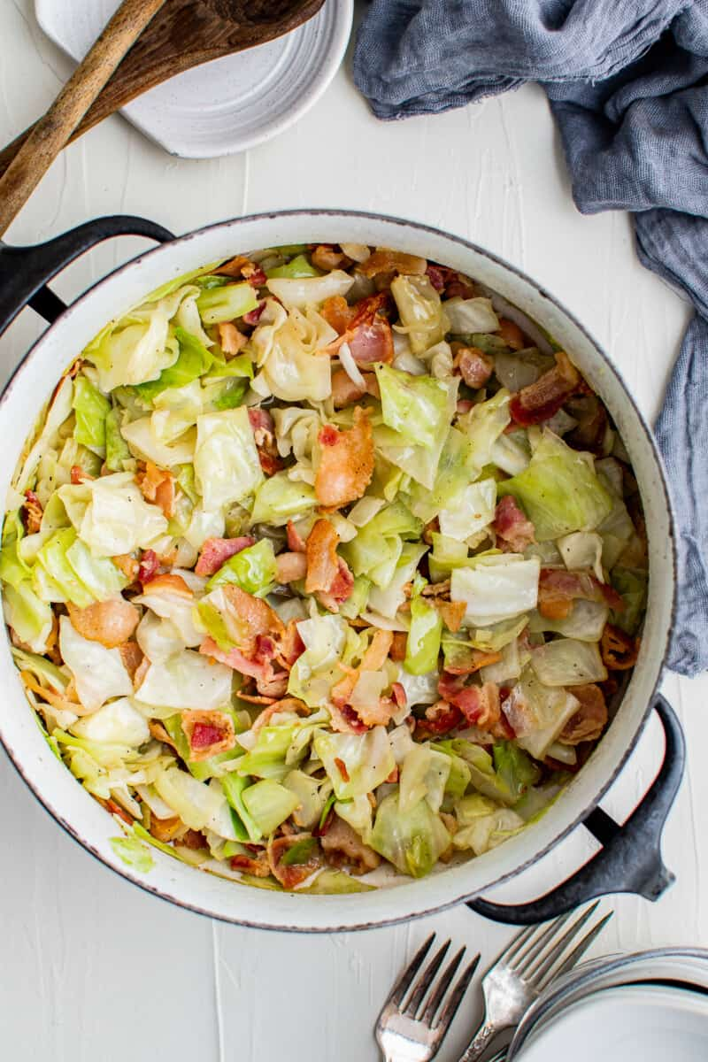 cabbage and bacon in blue dutch oven