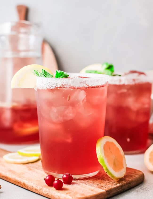 cranberry margaritas in glasses with salt rims