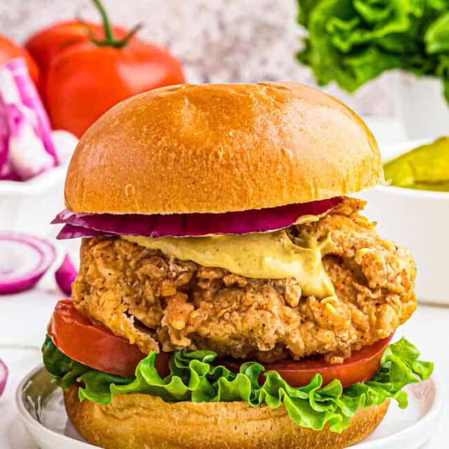 crispy chicken sandwich with bun on white table