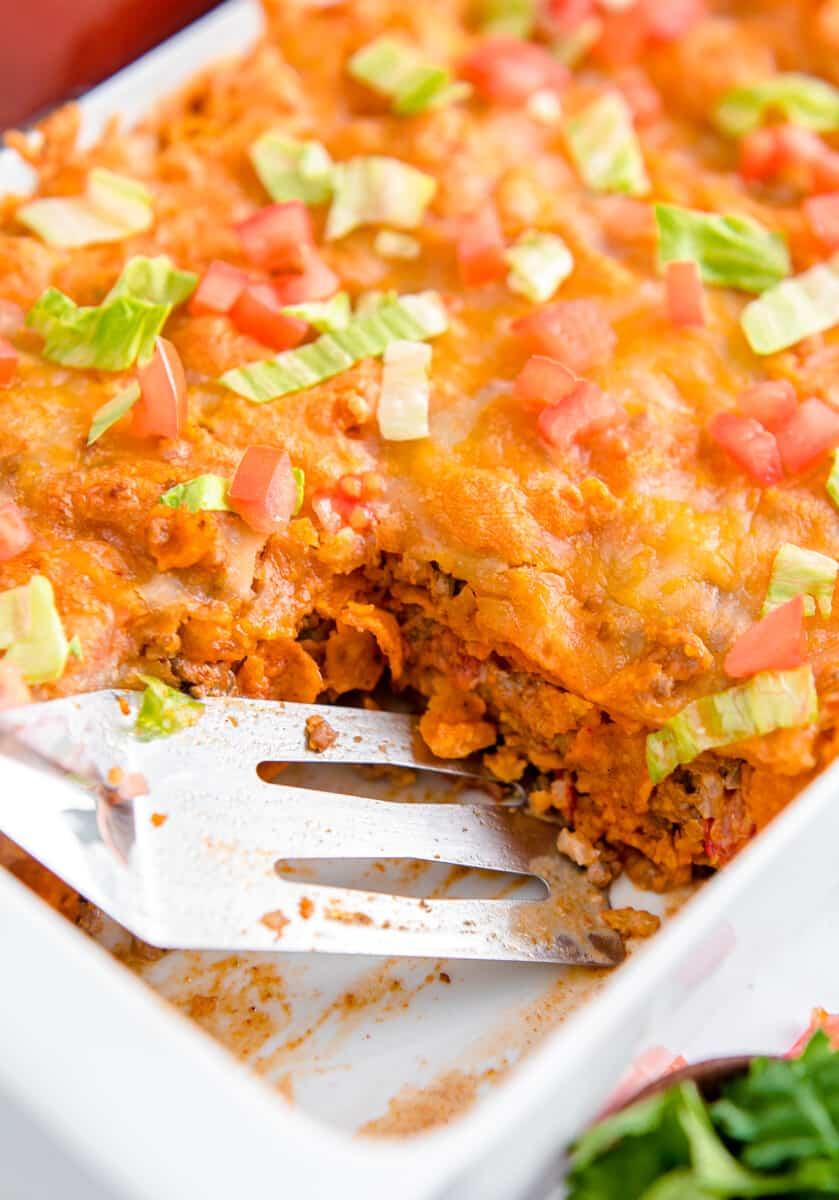layered dorito casserole in baking dish