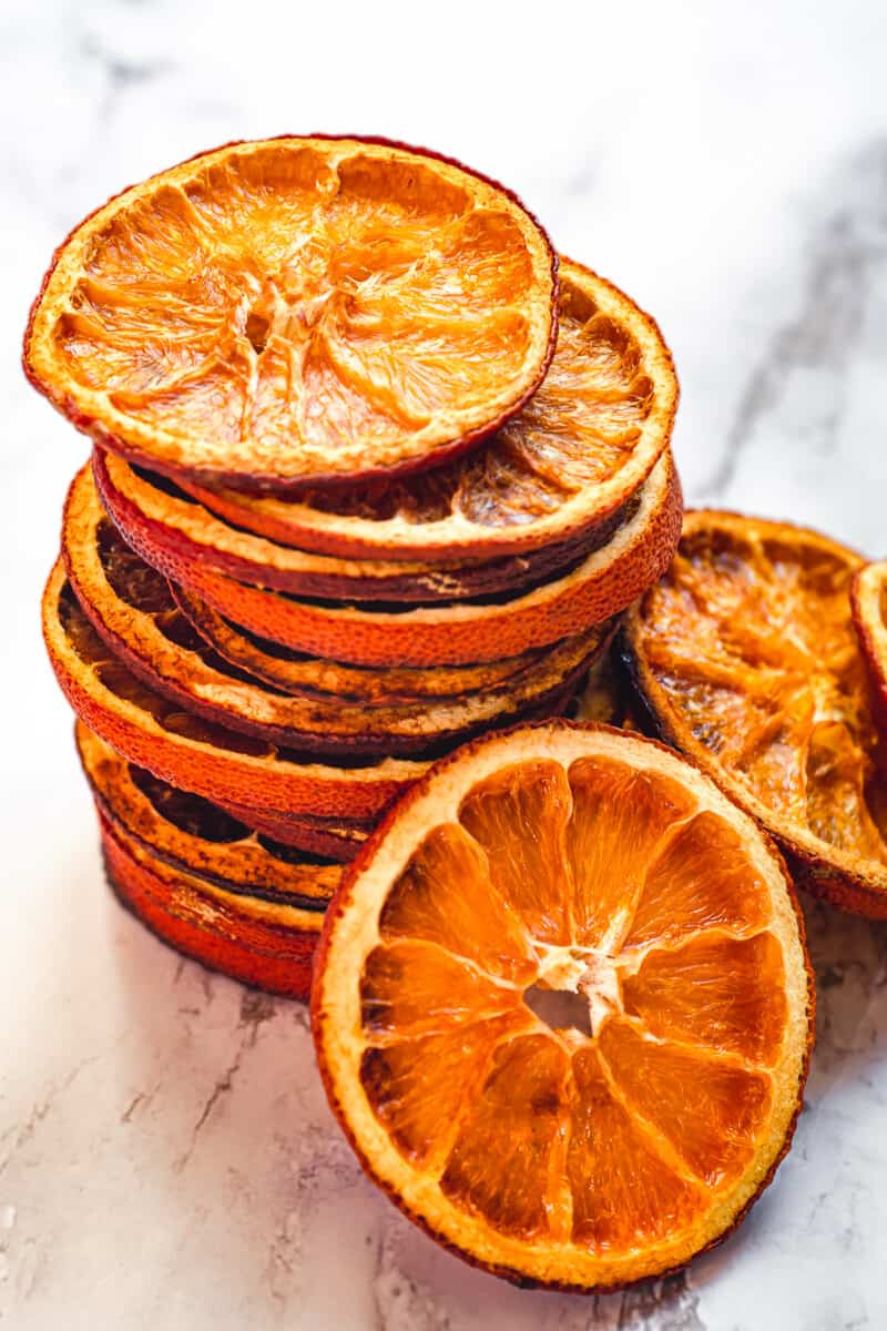 up close stacked dried orange slices on marble
