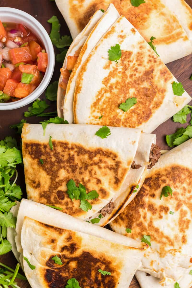 foldover tortilla quesadillas on cutting board