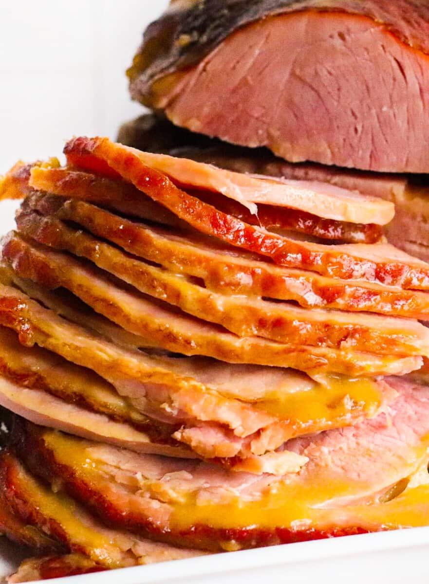 up close slices of honey mustard maple glazed ham