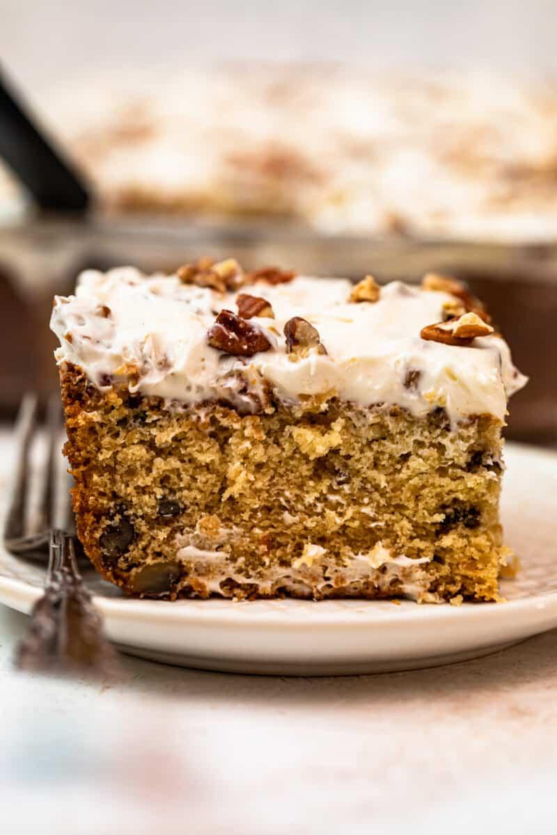 slice of italian cream cake with Cream Cheese Pecan Frosting