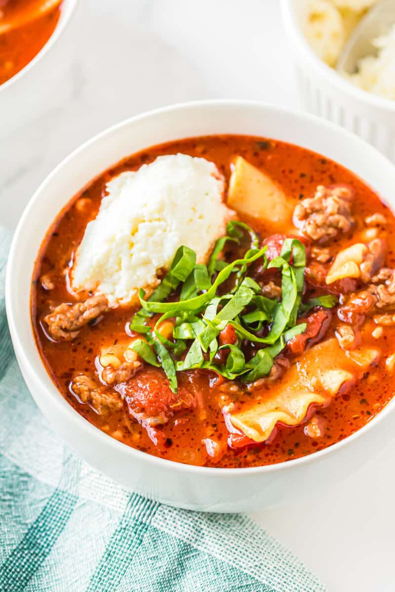 lasagna soup garnished with ricotta and basil