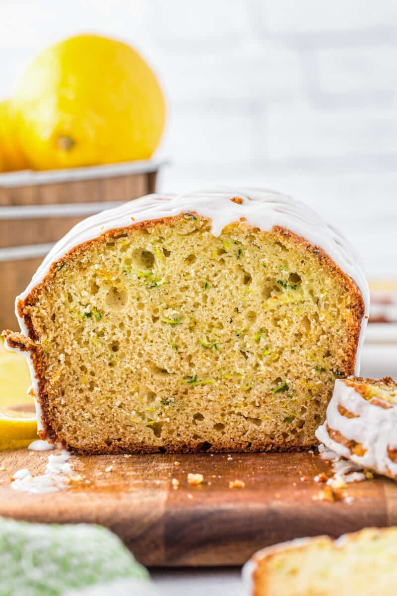 sliced lemon zucchini bread with icing