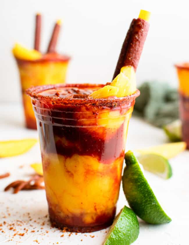 layered mangonadas in plastic cups