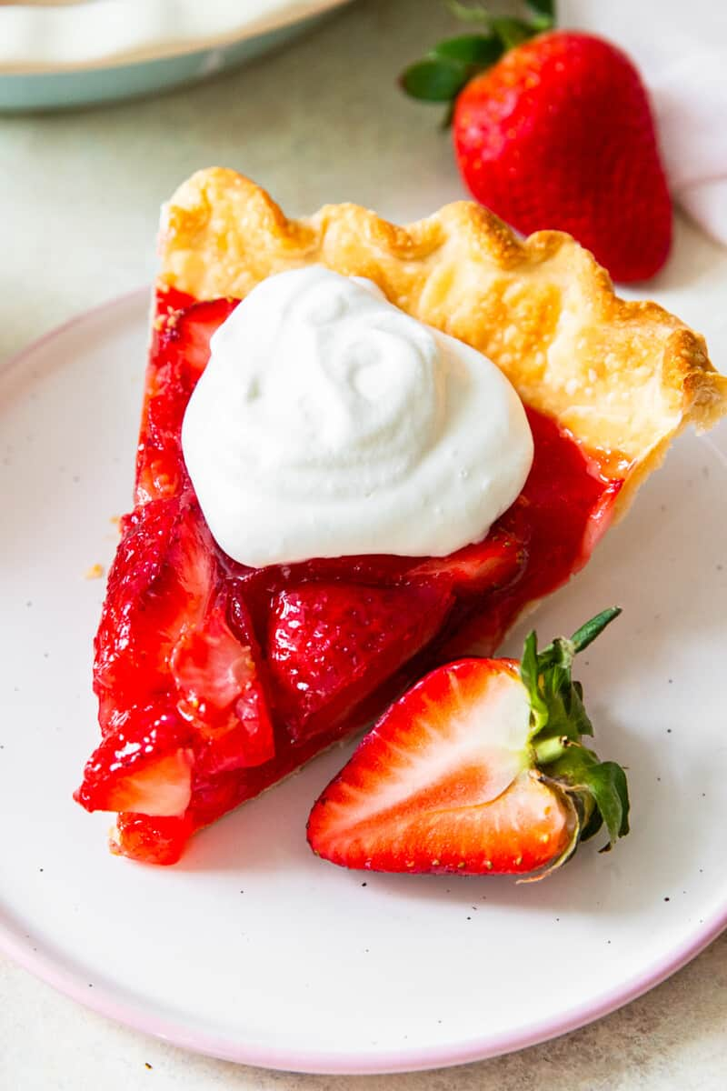 slice of strawberry jello pie with whipped cream