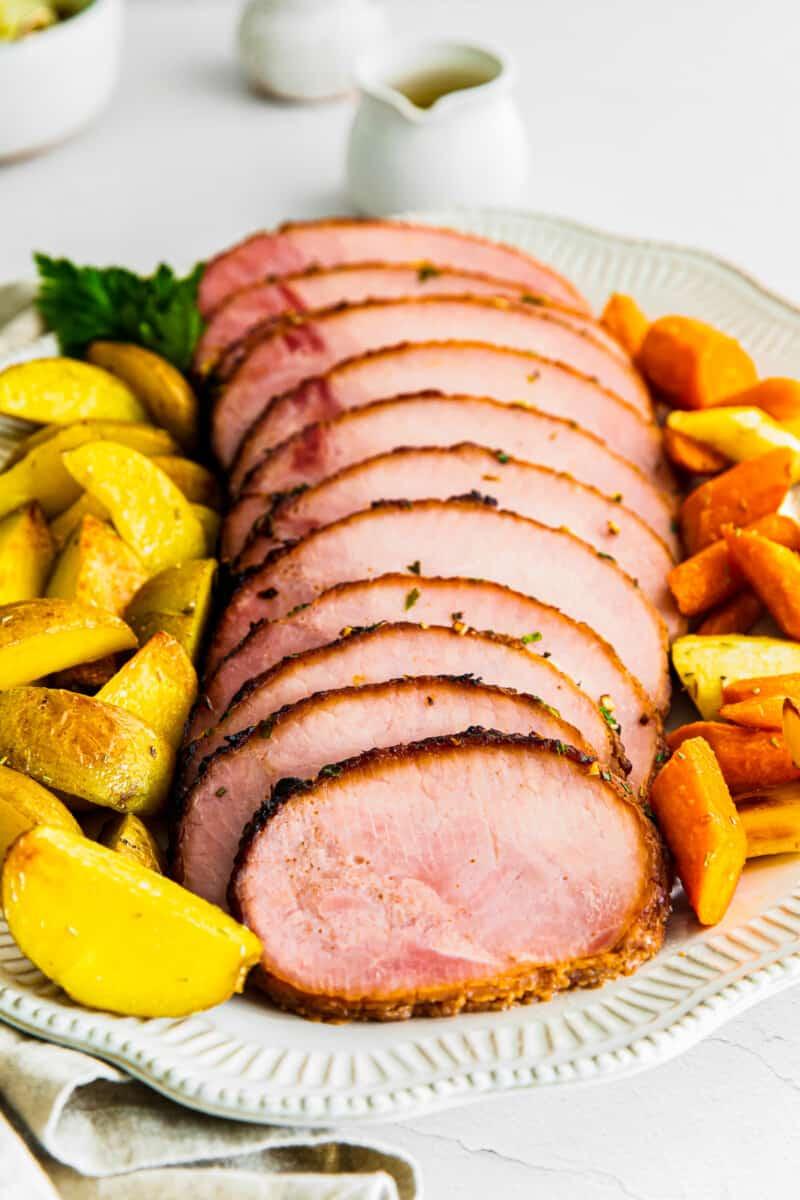 air fryer ham with garlic herb butter on platter