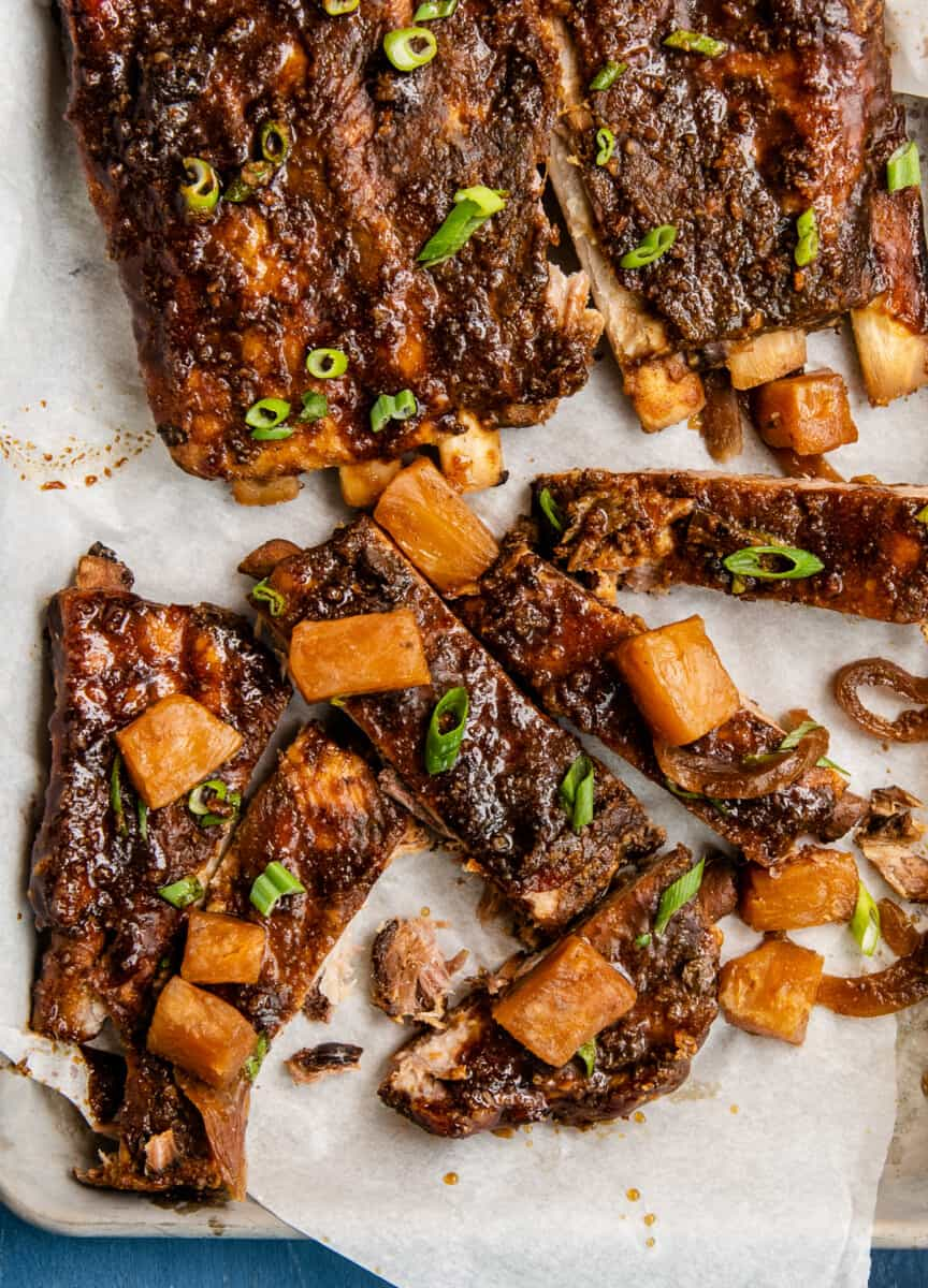 crockpot hawaiian ribs on sheet pan with pineapple