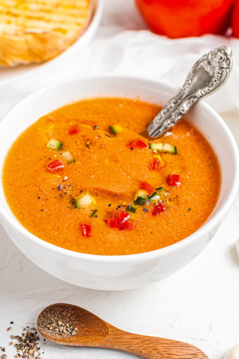 side shot of gazpacho with silver spoon