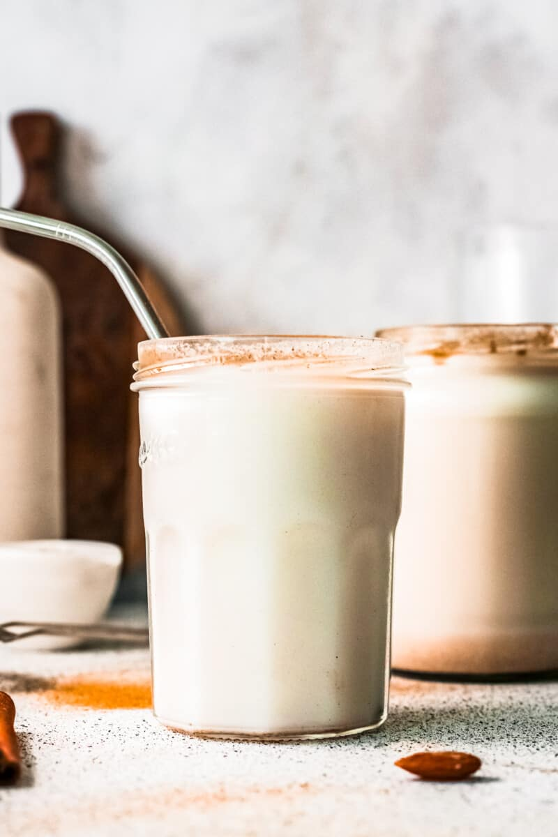 two glasses of horchata with metal straws