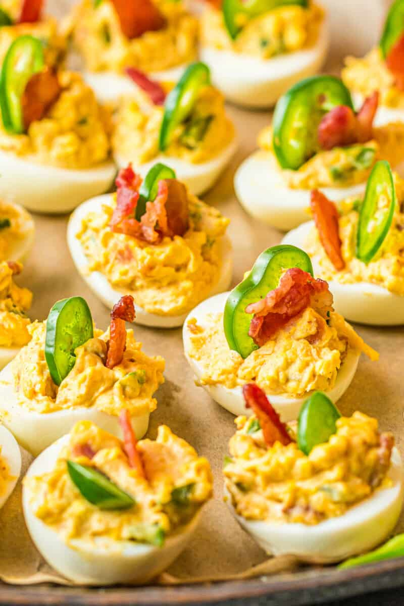 jalapeno popper deviled eggs on platter