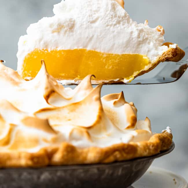 lifting up slice of lemon meringue pie