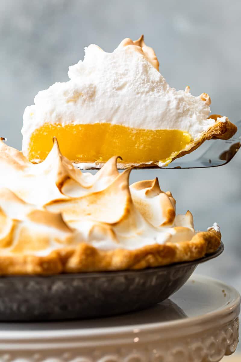 lifting up slice of lemon meringue pie