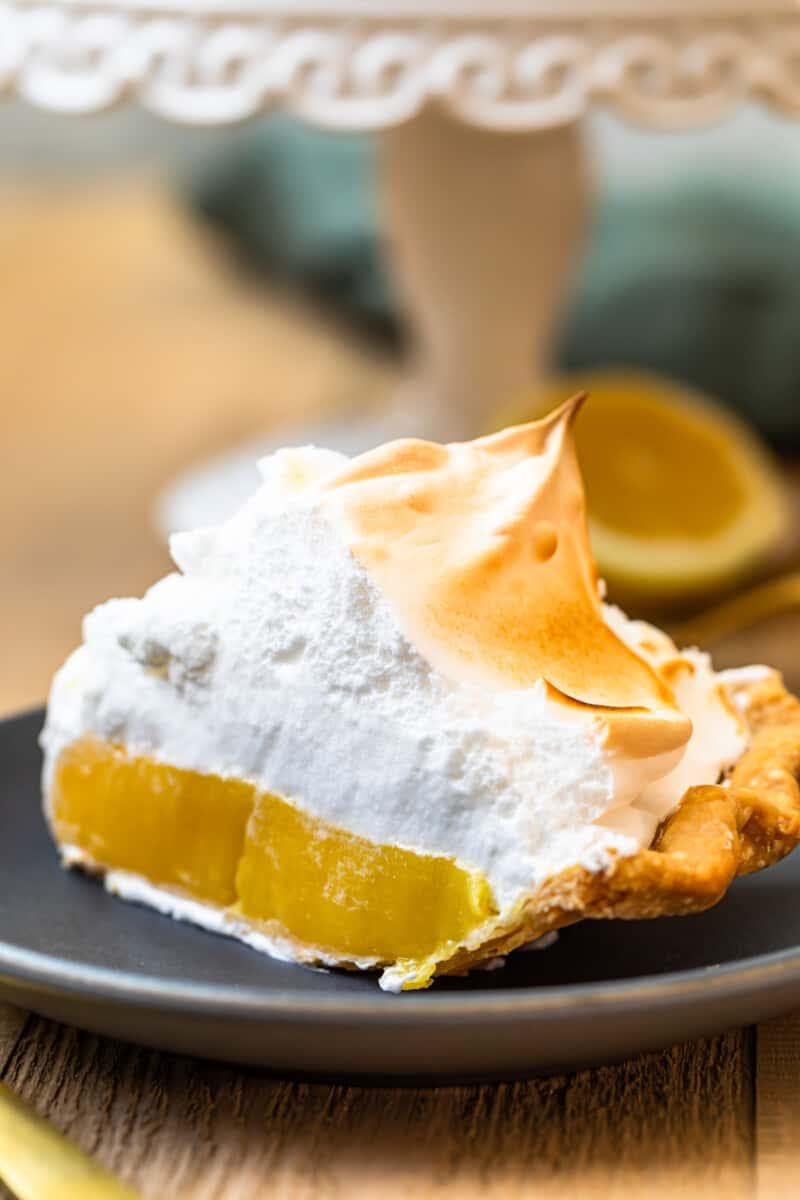 slice of lemon meringue pie on grey plate
