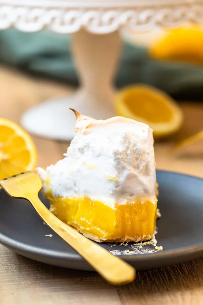 slice of lemon meringue pie with bite out