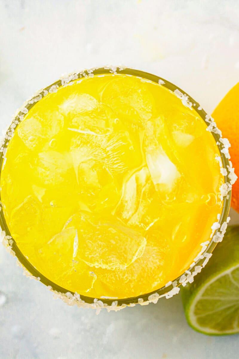 overhead orange margarita with salt rim