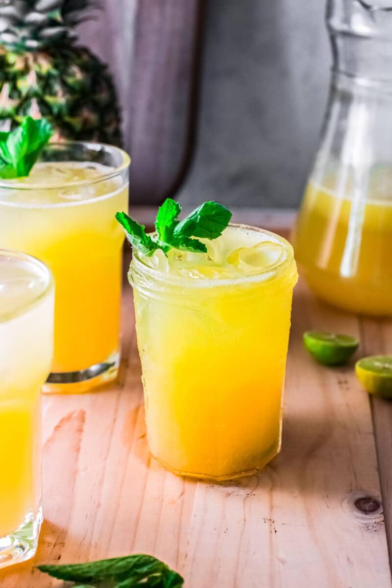 three glasses of pineapple agua fresca