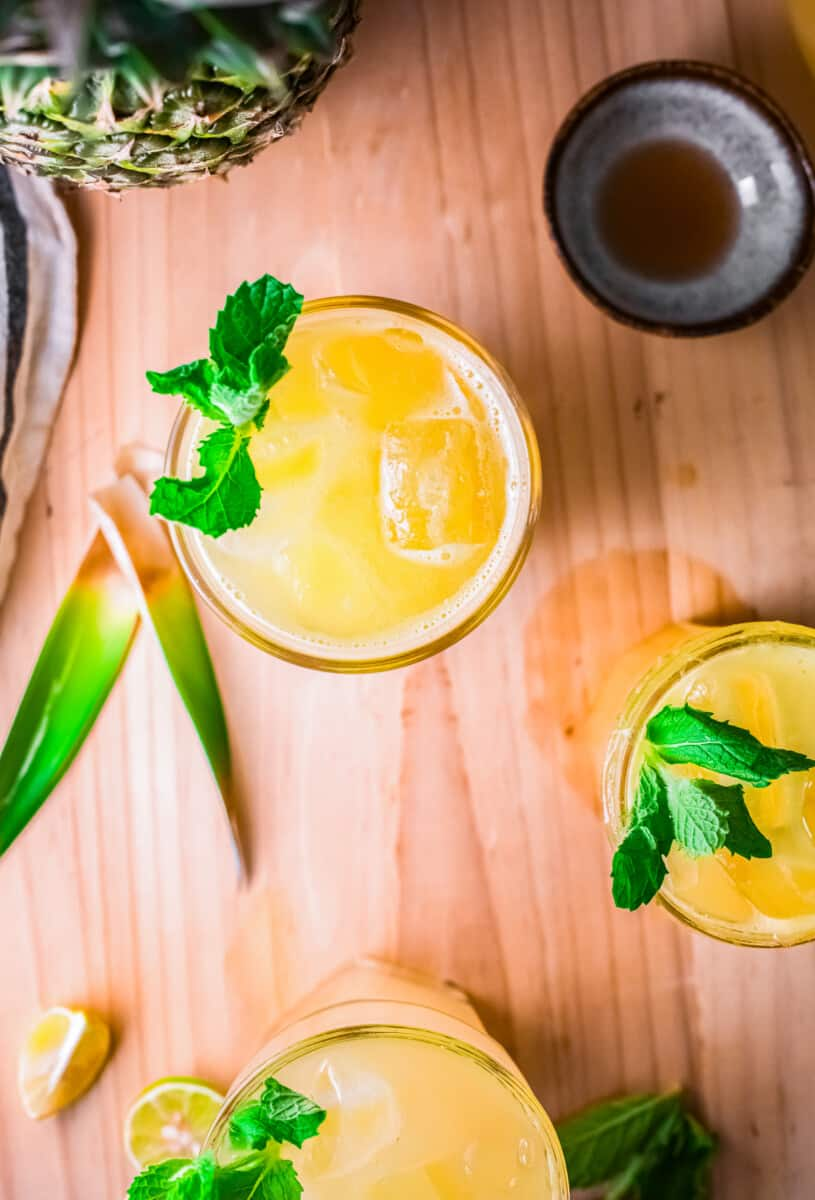 overhead image of pineapple agua fresca garnished with mint