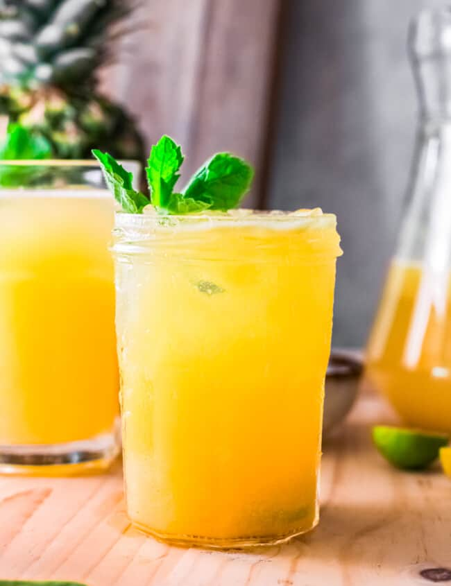 pineapple agua fresca in glass garnished with mint