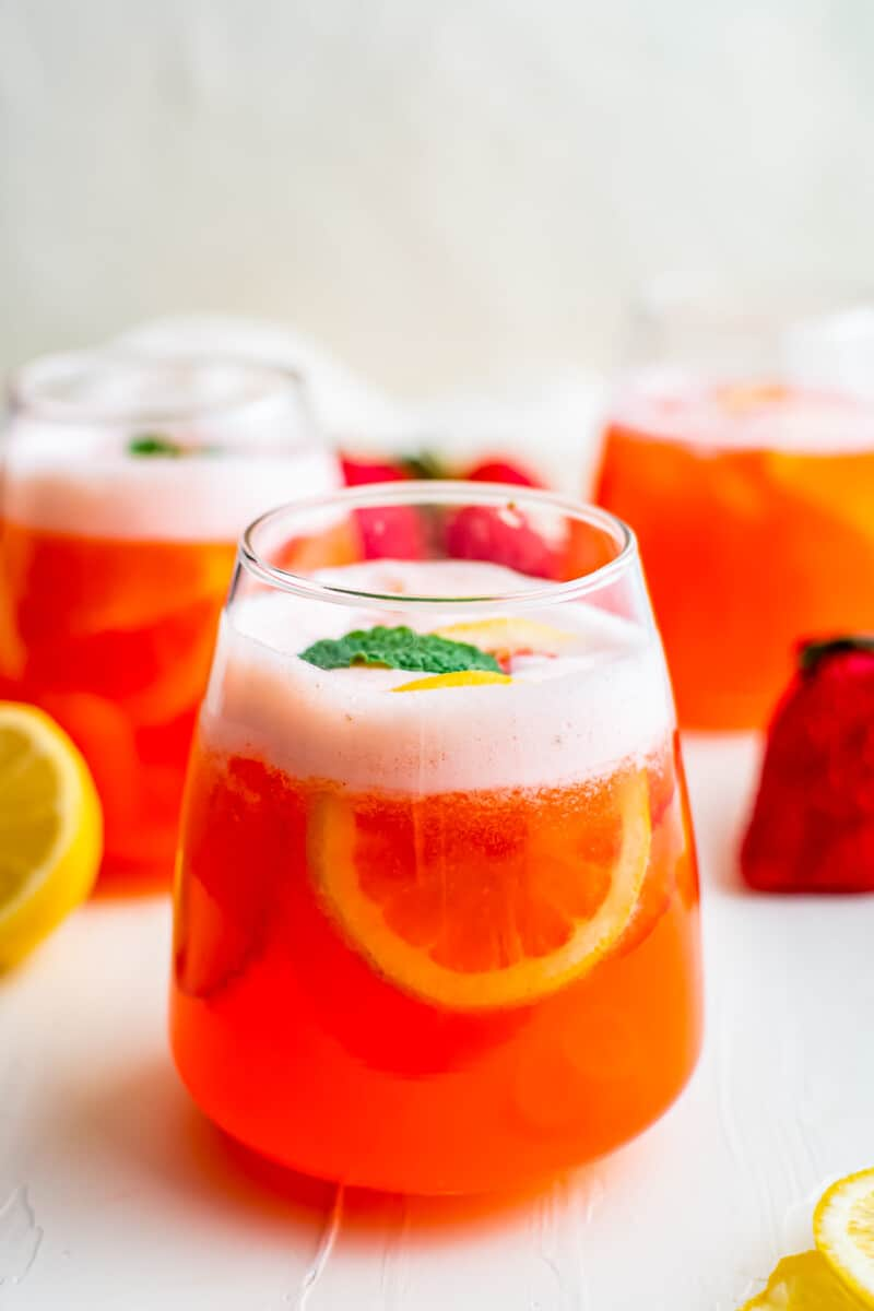strawberry lemonade in glasses garnished with mint