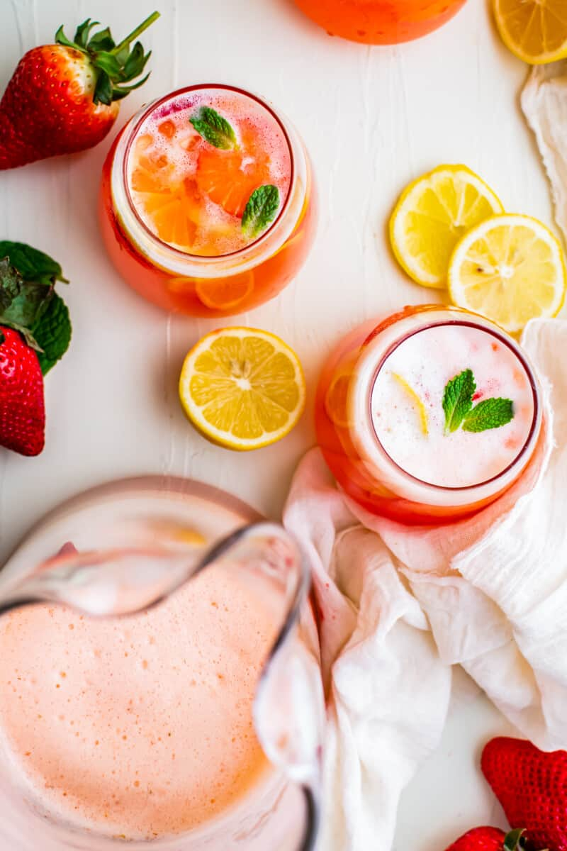 overhead strawberry lemonade in pitcher and glasses