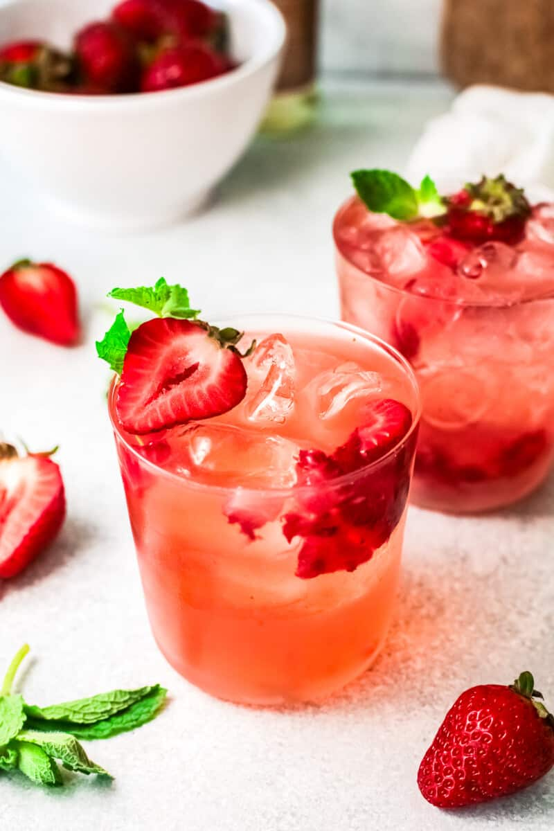 two glasses with strawberry palomas