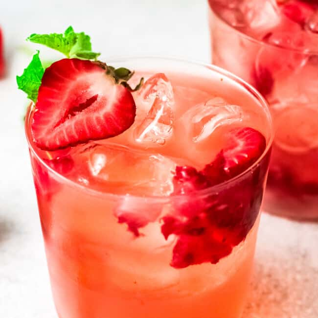two glasses filled with strawberry palomas