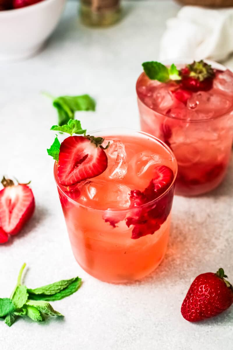 strawberry palomas garnished with strawberry slices