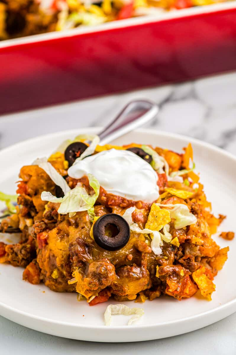 taco casserole on plate garnished with sour cream