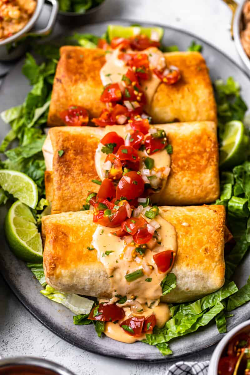 3 baked chicken chimichangas on serving platter