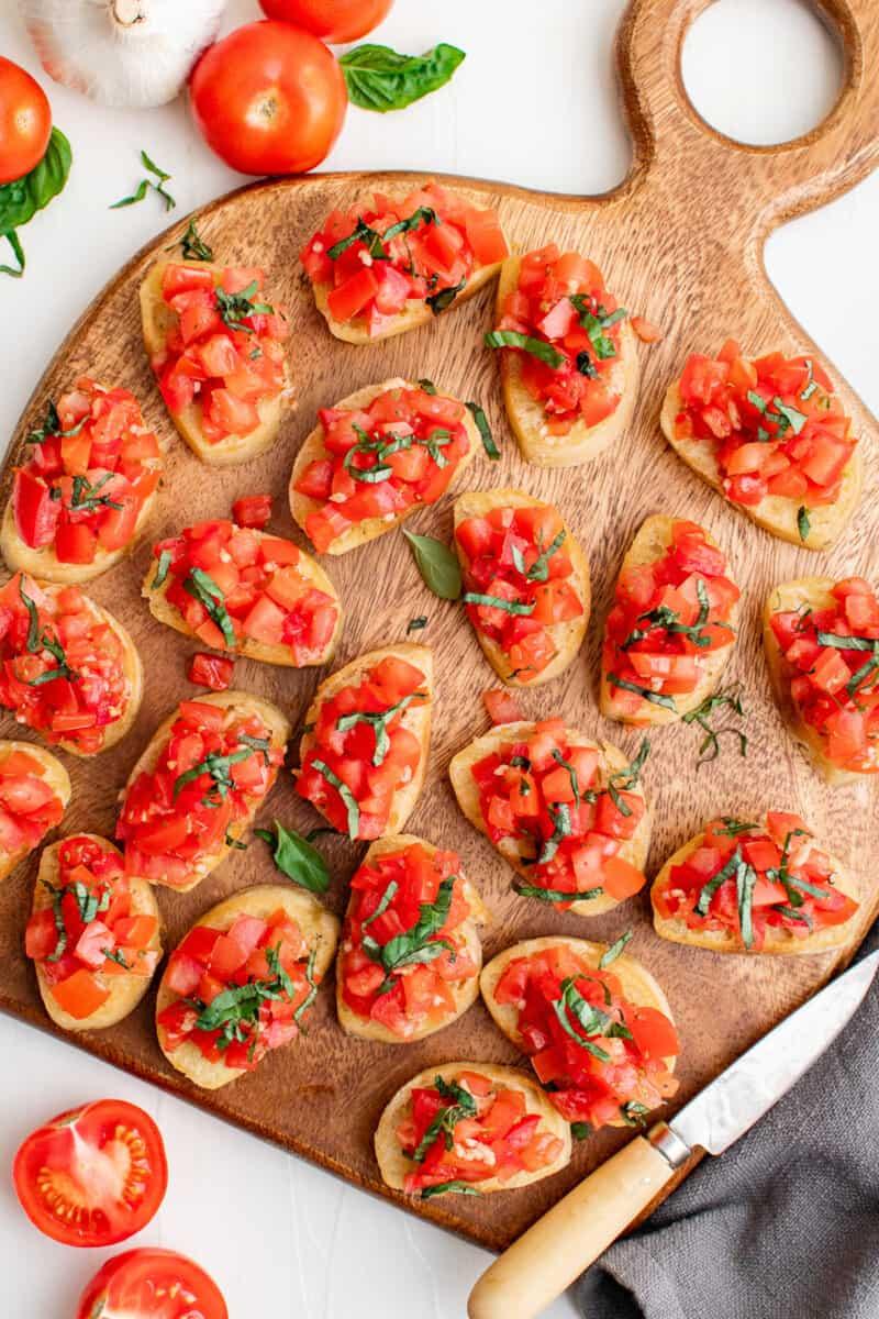 tomato bruschetta on wooden platter