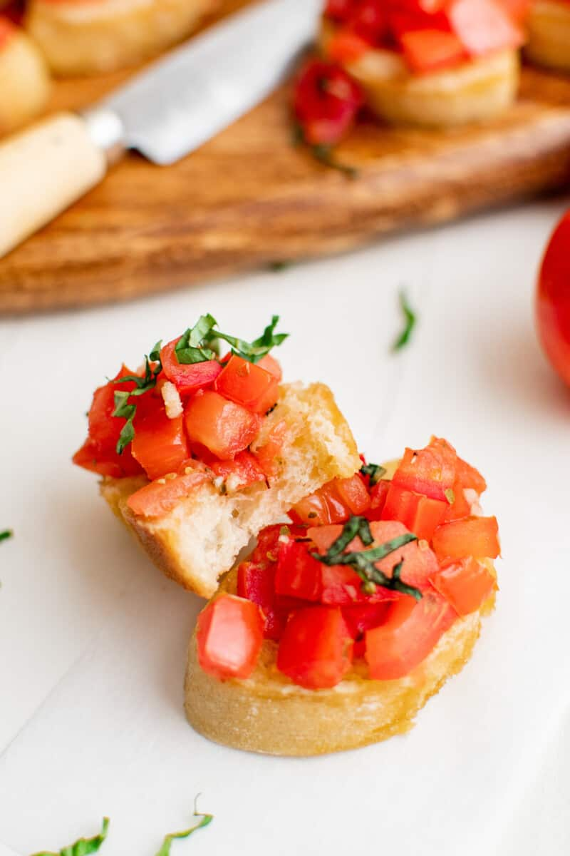two slices of bruschetta with tomatoes