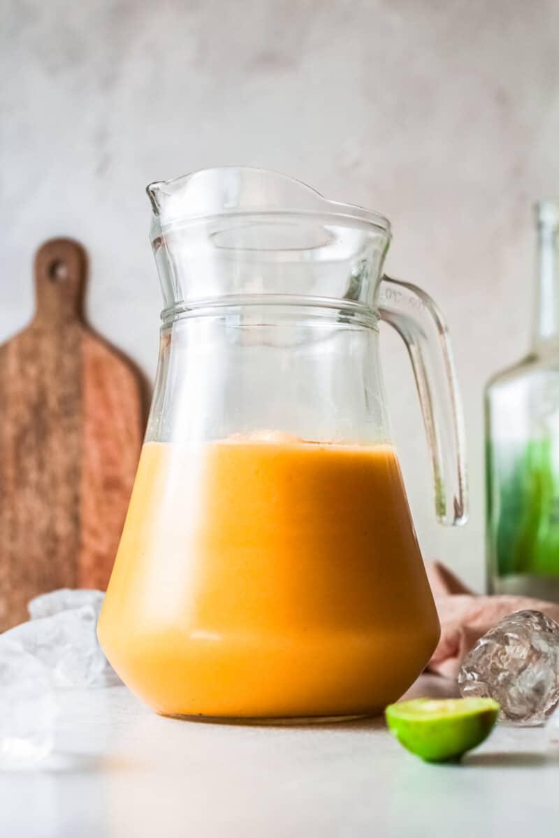 pitcher of frozen peach margaritas