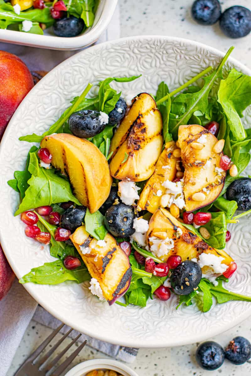 grilled peach salad with feta in bowl