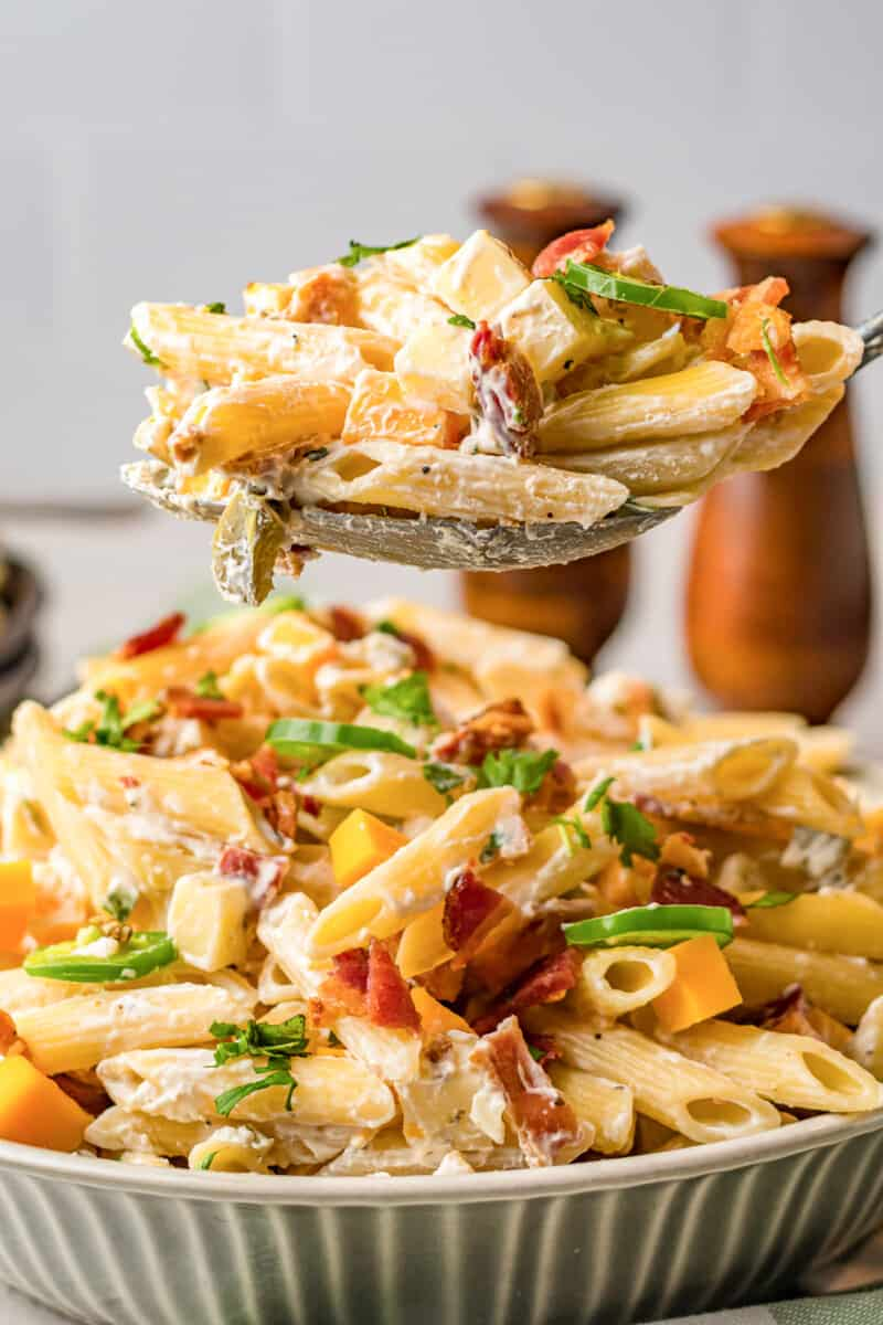 lifting up spoonful of jalapeno popper pasta salad