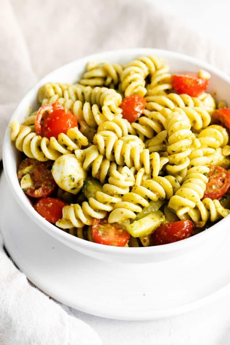 pesto pasta salad in white bowl