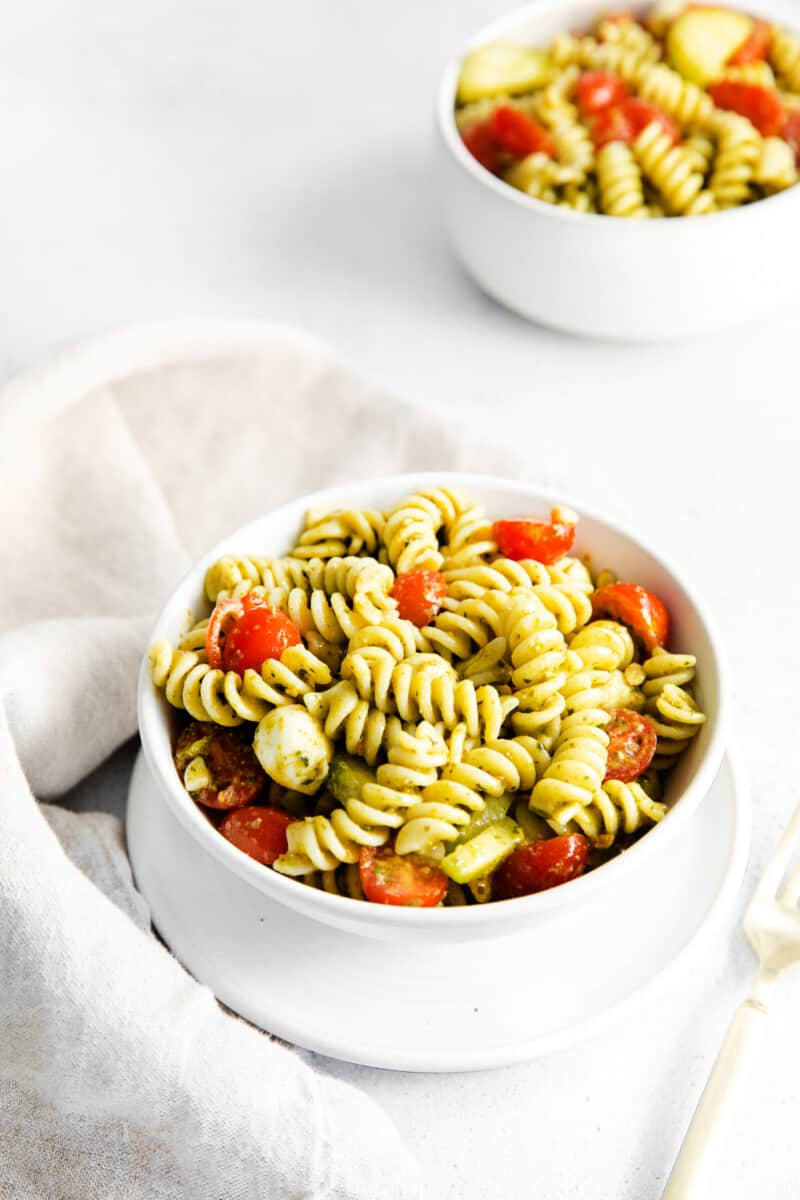 pesto pasta salad in white bowls