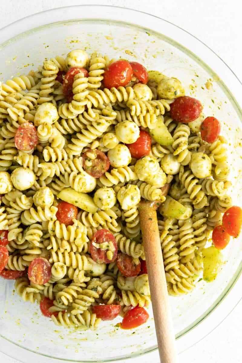 large mixing bowl with pesto pasta salad