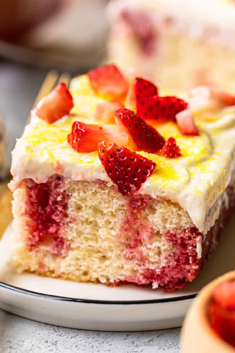 up close slice of strawberry lemonade poke cake