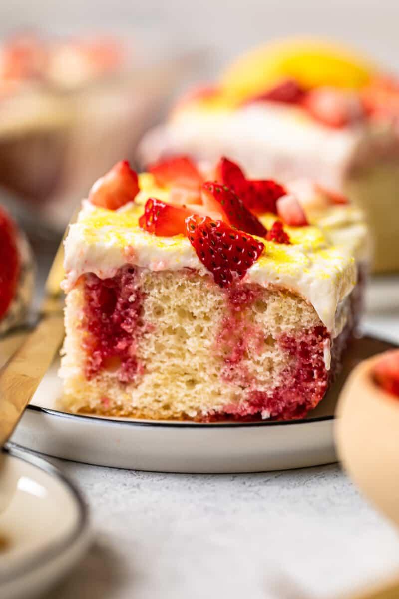 slice of strawberry lemonade poke cake