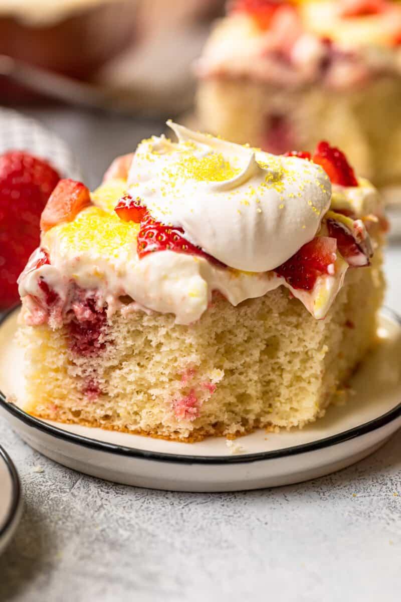 bite out of strawberry lemonade poke cake