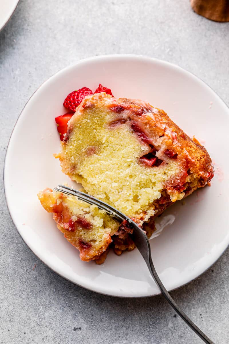 slice of glazed strawberry pound cake with silver fork